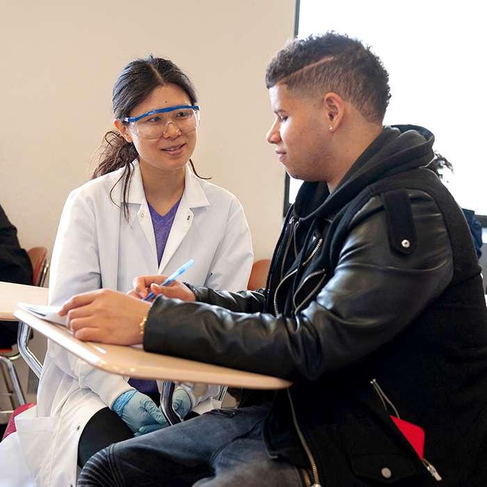 Student receiving help from professor